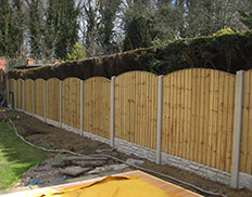 Bowtop Vertilap Fence with concrete posts & gravel boards