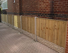 Vertilap Fence with concrete posts & gravel boards